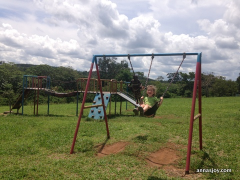 Ayla swinging with a new friend at Good Shepherd's Fold