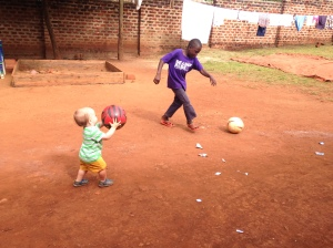 Judson learning some football skills from Alamanzan.