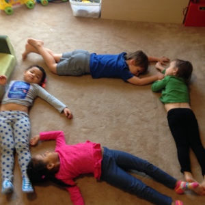 Making a square with their bodies for Geometry. Or nap time.