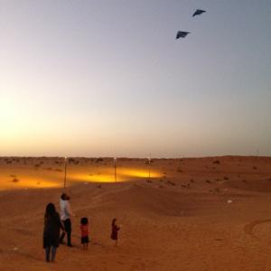 Flying kites in the desert